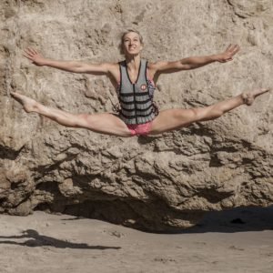 woman jumping in weight vest