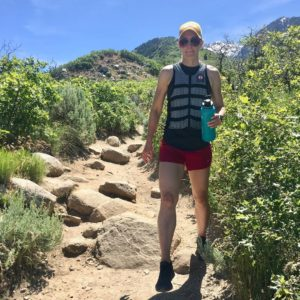 woman hiking in weight vest