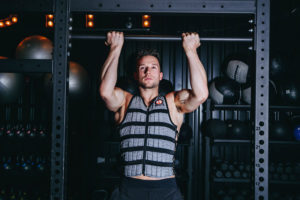 man doing pullup with weight vest